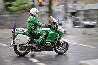 Beamter - Ein Beamter der Polizei auf einem Motorrad