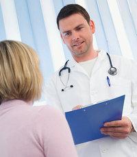 Doktor - Arzt mit Patientin