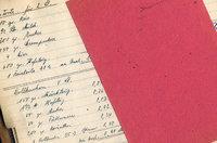 Fließpapier - Rotes Fließpapier auf einem Heft