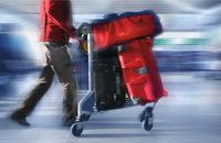 Gepäck - Gepäck auf einem Kofferkuli