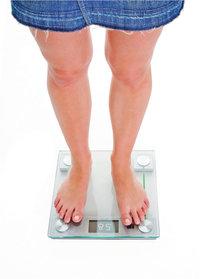 Gewichtskontrolle - Gewichtskontrolle mit einer Waage