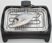 Grill - Fisch auf dem Grill eines Grillgeräts