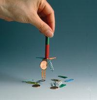 Magnet - Ein Magnet mit magnetischen Gegenständen
