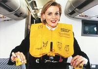 Rettungsweste - Stewardess mit gelber Rettungsweste