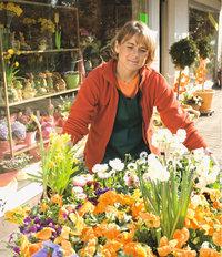Verkäuferin - Verkäuferin von Blumen